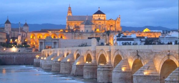 view of the mezquita and roman bridge cordoba spain